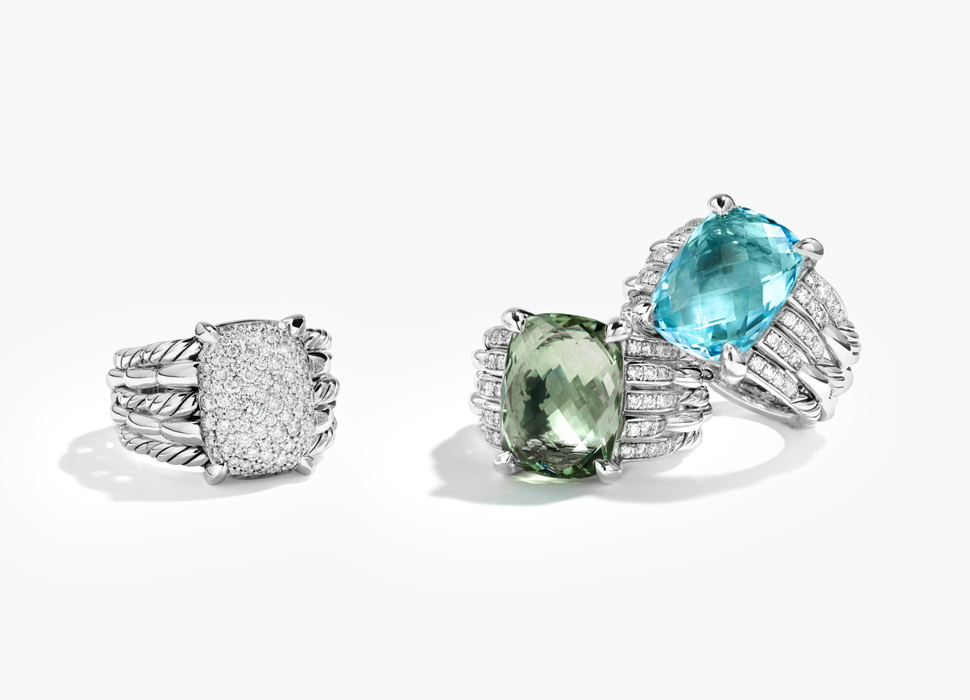 Silver rings with blue, green, and white precious stones