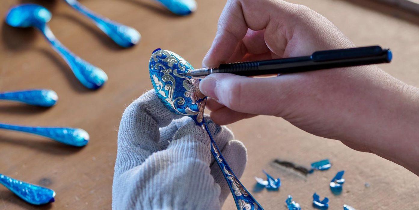 A craftsperson details an ornate Christofle spoon