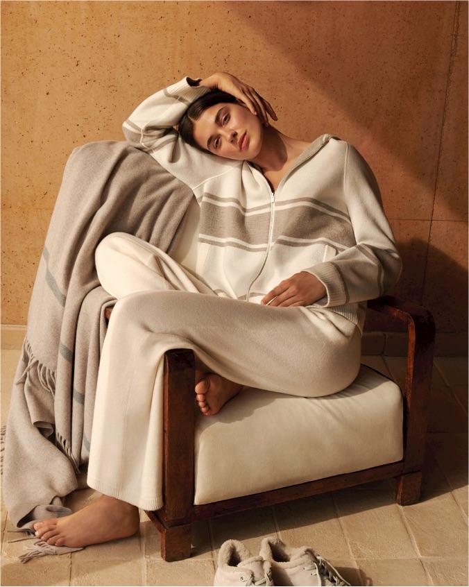 A woman wearing cashmere loungewear by Loro Piana