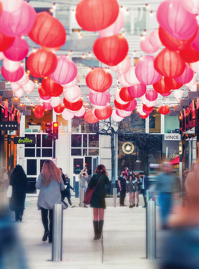 A red lantern light installation hangs above Palmer Alley at CityCenterDC