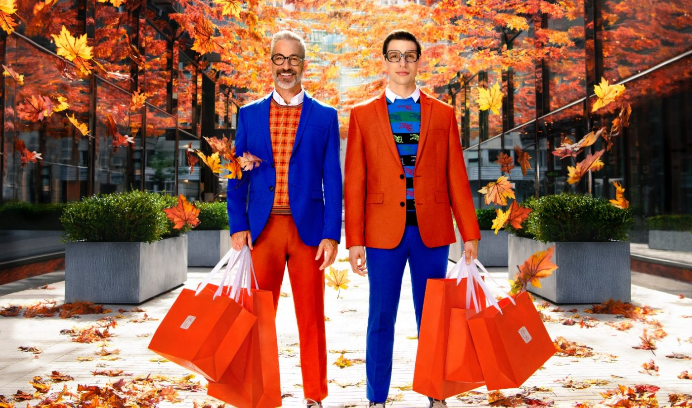 Two men stand beneath fall leaves in Palmer Alley