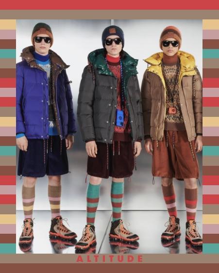 Three men wearing puffy Moncler winter jackets