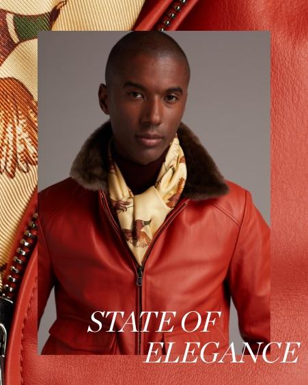 A man wearing a red leather Paul Stuart jacekt